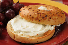 Onion bagel with cream cheese and grapes Stock Photos