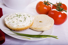 Onion Bagel and Tomatoes. Onion Bagel Chives and Tomatoes royalty free stock images