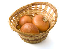 Onion in the basket. There are same onions in the basket on the white background Royalty Free Stock Image