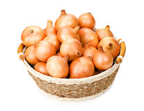 Onion in the basket isolated Royalty Free Stock Image