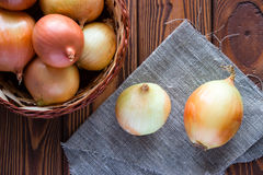 Onion in basket and napkin Royalty Free Stock Photography