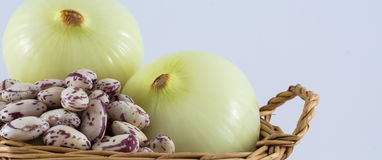 Onion and beans. In basket on white background Royalty Free Stock Photo