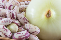 Onion and beans. Close up of beans and onion, classic dish Stock Photos