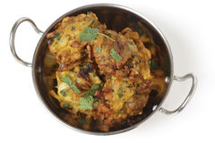 Onion bhajis in a kadai top view. Homemade onion bhaji Indian appetisers in a kadai serving bowl, seen from above Royalty Free Stock Images