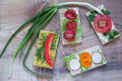 Onion and bread with different vegetables Royalty Free Stock Photos