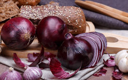 Onion, bread and garlic Stock Photography