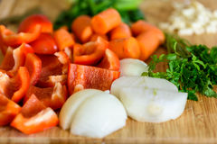 Onion, Carrots, Bell Peppers, Garlic And Parsley Raw Vegetables Ingredients Royalty Free Stock Image