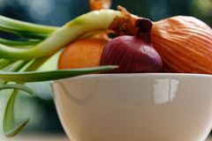 Onion collection in white dish stock photos