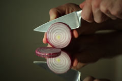 Onion cut with knife Royalty Free Stock Images
