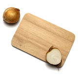 Onion on cutting board Stock Images