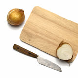 Onion on cutting board with knife Royalty Free Stock Photography
