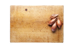Onion on a cutting board. Wooden cutting board with onions, top view Stock Images