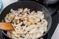 Onion fried in a pan. Onion is in the pan , ready for use Royalty Free Stock Image