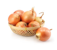 Onion fruits in the basket isolated on white Stock Photo