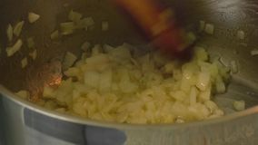 Onion frying in a pan stock video footage