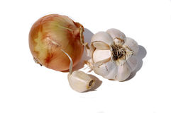 Onion and garlic. Cloves of garlic and an onion Royalty Free Stock Photography