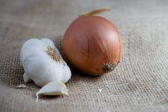 Onion and Garlic on Burlap Stock Photo