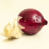 Onion and garlic close-up. Peeled red onion and garlic close-up on white background Stock Photos