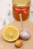 Onion, garlic, lemon and honey in glass jar, healthy nutrition and strengthening immunity Stock Photography