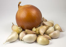 Onion and garlic. Natural and fresh ingredients for cooking Royalty Free Stock Photography