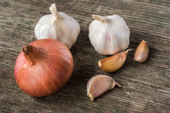Onion and garlic on the old desk.  royalty free stock photography