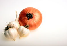 Onion and garlic. On white Stock Photos