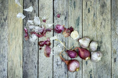 Onion and garlic on wood plank Royalty Free Stock Images