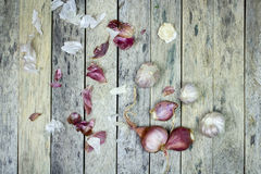 Onion and garlic on wood plank Royalty Free Stock Photo