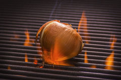 Onion on a Hot Flaming Grill Stock Photo