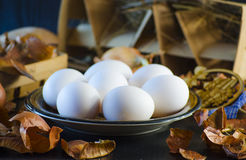 Onion husks and eggs. Onion husks for painting eggs for the Easter holiday Stock Photos