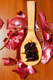 Onion jam on a wooden spoon Stock Image
