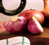 Onion in the kitchen Stock Images