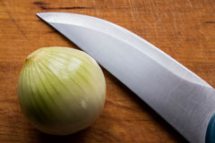 Onion , knife and wood Royalty Free Stock Image
