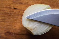 Onion , knife and wood Royalty Free Stock Photography