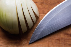 Onion , knife and wood Stock Photos