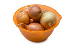 Onion in an orange bowl Royalty Free Stock Photo