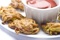 Onion pakoda with sauce Royalty Free Stock Photo
