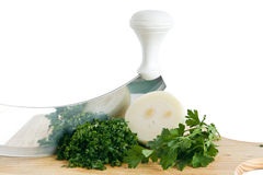 Onion parsley with chopping knife Royalty Free Stock Images