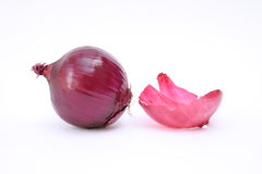 Onion with peel Royalty Free Stock Image
