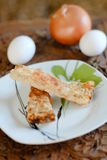 Onion pie and some ingredients. Piece of onion pie and some ingredients eggs & onion Royalty Free Stock Photo