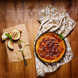 Onion pie or tart served with grilled onion Royalty Free Stock Images