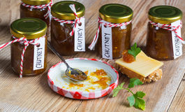 Onion pineapple chutney on rustic wood Royalty Free Stock Images