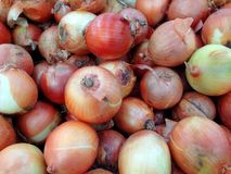 Onion putting piles together to wait for people to buy in the market. stock photos