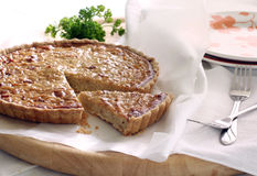 Onion quiche. French onion quiche with a portion cut out Stock Photo