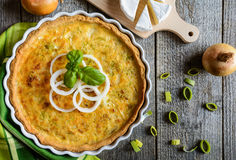 Onion Quiche with Camembert, leek and eggs. French Quiche with onion, Camembert, leek and eggs filling Royalty Free Stock Photo