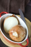 Onion in red bowl Royalty Free Stock Photos