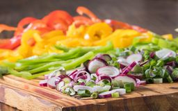 Onion and red, green and yellow chili peppers cut in julienne stock photos