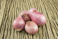 Onion. Red onion on old wooden surface brown Royalty Free Stock Photo