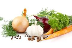 Onion,red onion,dill,parsley,pepper,garlic,carrots on white Royalty Free Stock Photo