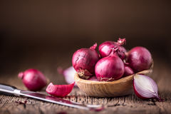 Onion. Red onions on very old oak wood board Stock Photography